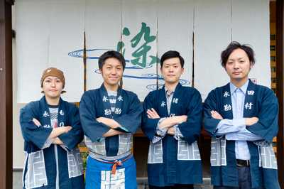 Masaki Nagano (second left) and staff at Nagakansome textile printing company
