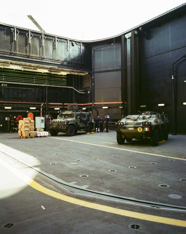 Combat vehicles in a hangar on one of 'Cavour's' 30-tonne elevators