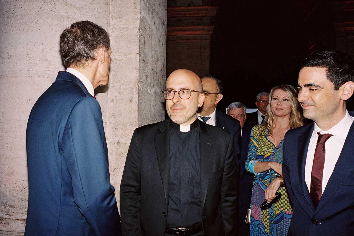 In Rome, the night doesn't begin until a priest shows up