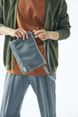 Cardigan by Altea, t-shirt by Steven Alan, trousers by Eleventy, bag by Porter