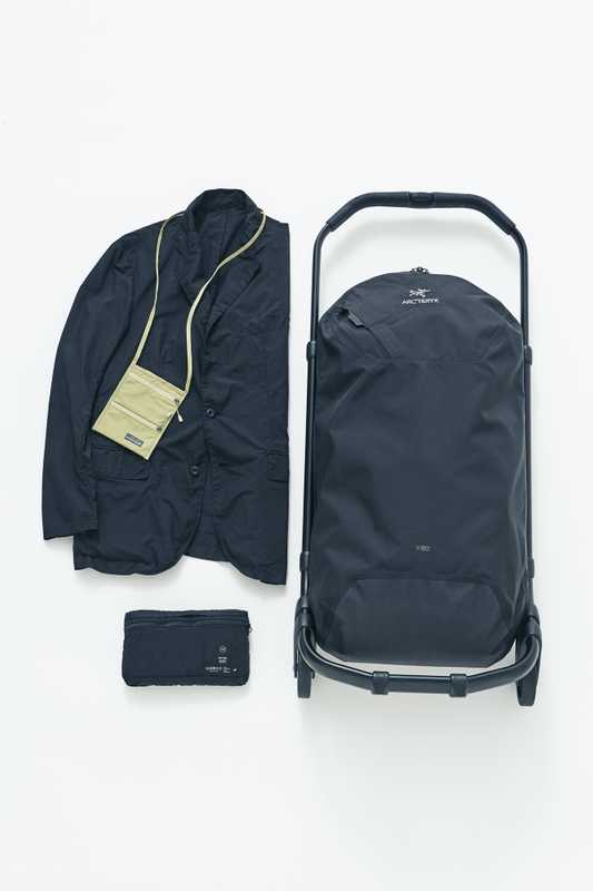 Jacket by Teatora, suitcase by Arc'teryx, passport pouch by Montbell
