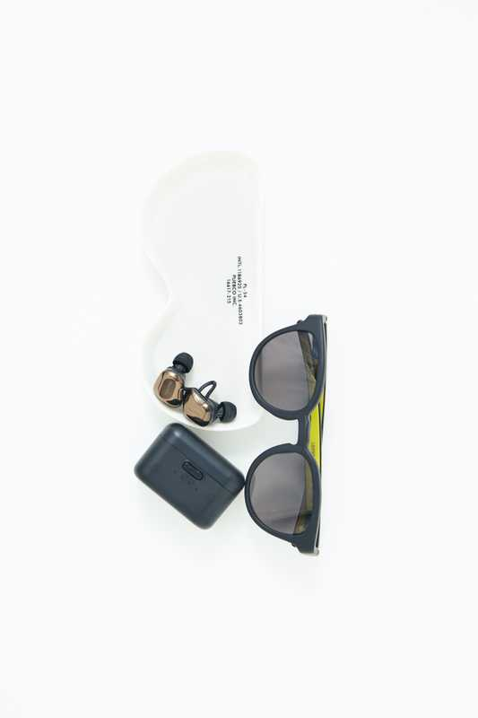Sunglasses by Eyevol,  glasses dish by Puebco, earphones by Nuarl