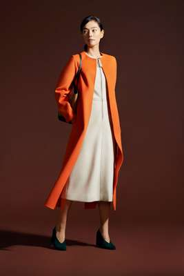 Coat by Salvatore Ferragamo, dress by Vanessa Seward, shoes by Cos, bag by Piquadro