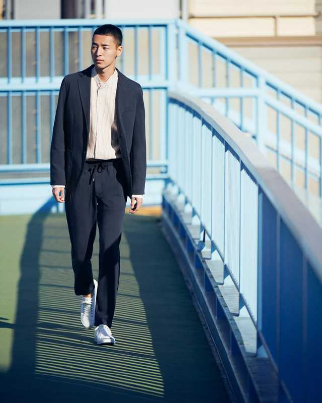 Jacket and trousers by Circolo 1901, shirt by Pal Zileri, trainers by Converse