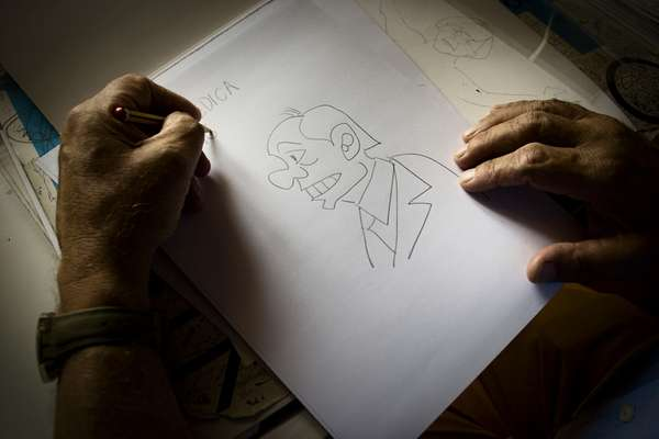 Giannelli sketches his favourite subject, Silvio Berlusconi