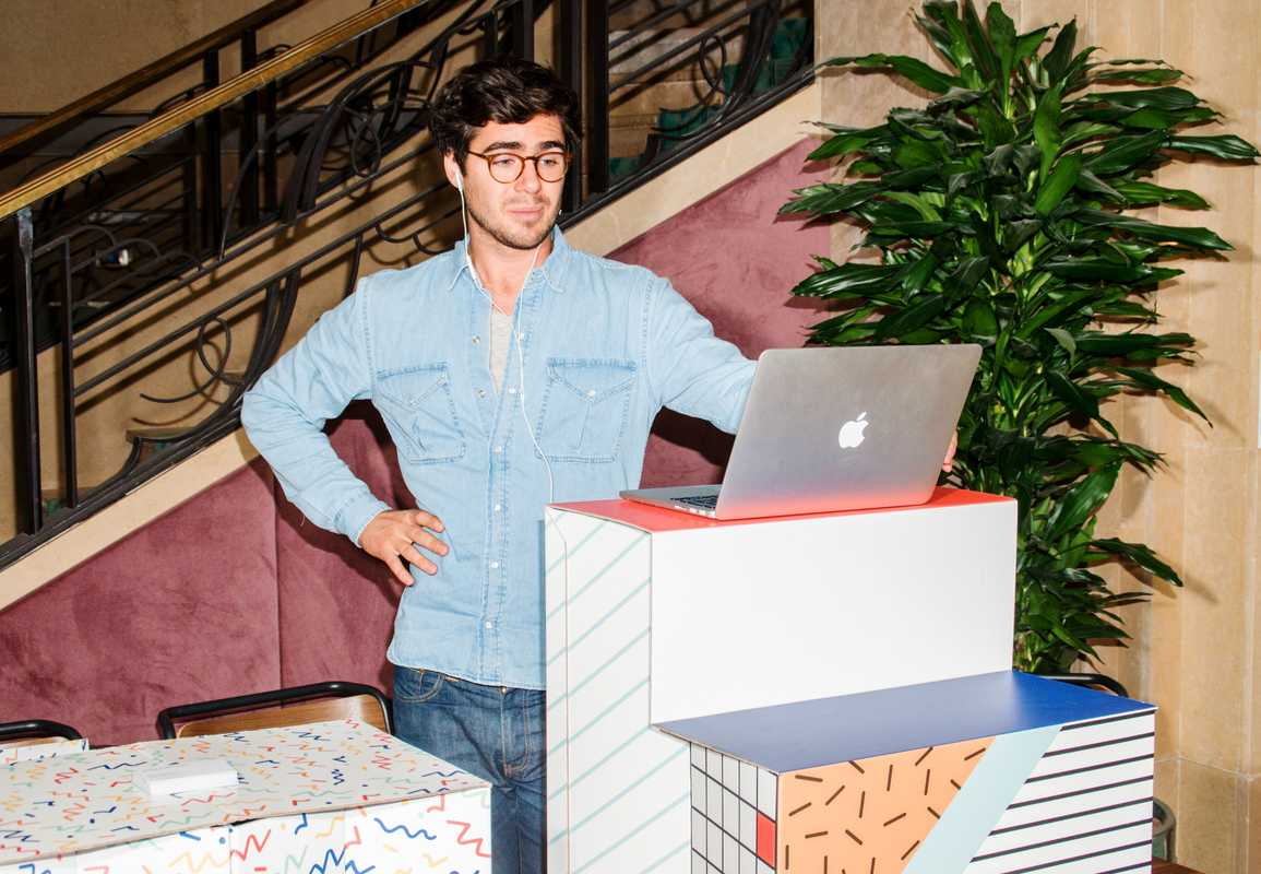 At a standing desk in WeWork, Paris