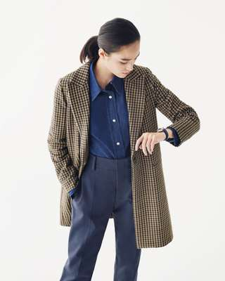 Coat by Circolo 1901, shirt by Arket, trousers by Sofie D'Hoore, watch by Tag Heuer —