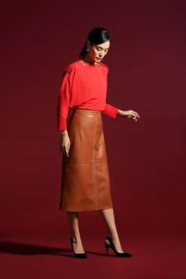 Top by J.Crew, skirt by Vanessa Seward, shoes by Christian Dior, earrings by Sarah & Sebastian