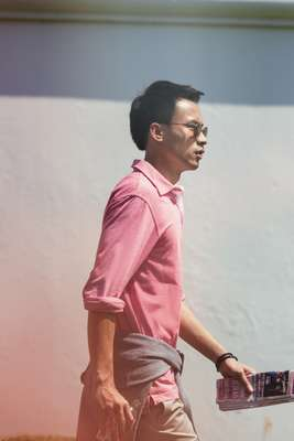 Sunglasses by Persol, polo shirt by Hackett, jumper (around waist) and shorts by Brioni, bracelet by Tod's
