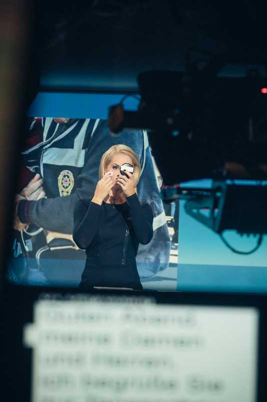 Presenter Judith Rakers powdering her nose in the studio
