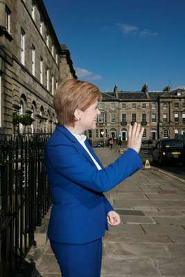 Saltire of the earth: the first minister  waving to admirers