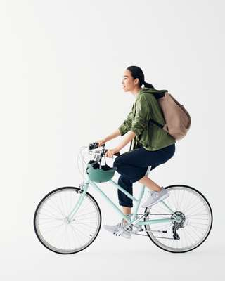 Jacket by Colmar, pullover by Tod's, trousers by Connolly, trainers by New Balance, backpack by Hang Minor, bike by Tokyobike, helmet by Bern