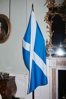 National flag adorning  a fireplace in the drawing room of Bute House