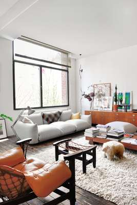 Inside the home of resident Pierre Lhoas. The sofa is by Arflex