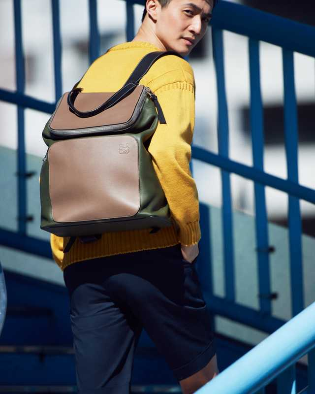 Jumper by Guernsey Woollens from Beams F, shorts by Tomorrowland, backpack by Loewe
