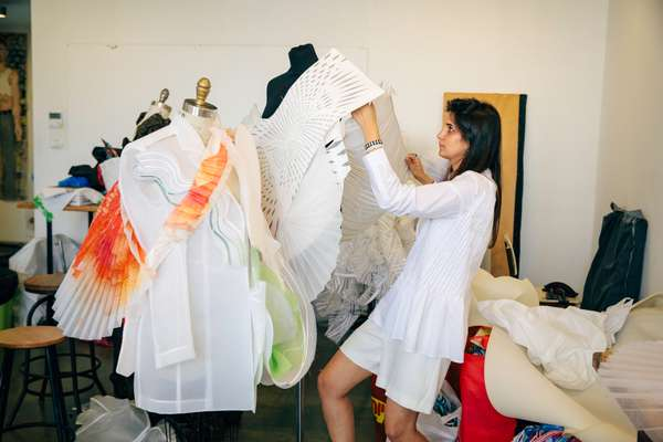 Student Shir Naeh working on her collection