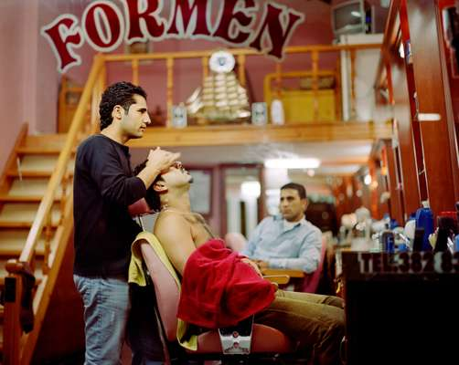 Adil Erten gets a post shave massage at a barber's in Byukada's bazaar