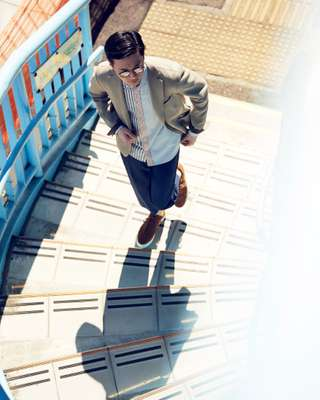 Jacket by Herno, polo shirt by Eleventy, shorts by Giabs Archivio from Beams
