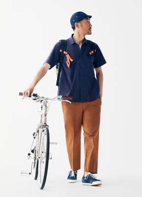 Shirt by Descente Pause, t-shirt by Acne Studios, trousers by Scye, trainers by Spalwart from Steven Alan, bike by Tokyobike, cap by Narifuri,  backpack by Finisterre