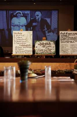 The central table with a still from a Charlie Chaplin film beamed onto the wall behind the create-your-own menus