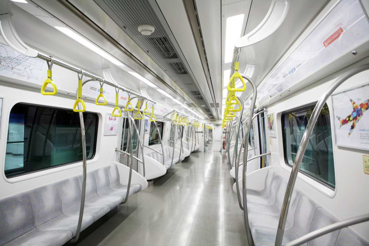 The interior of a subway car featuring Hyundai Capital ads