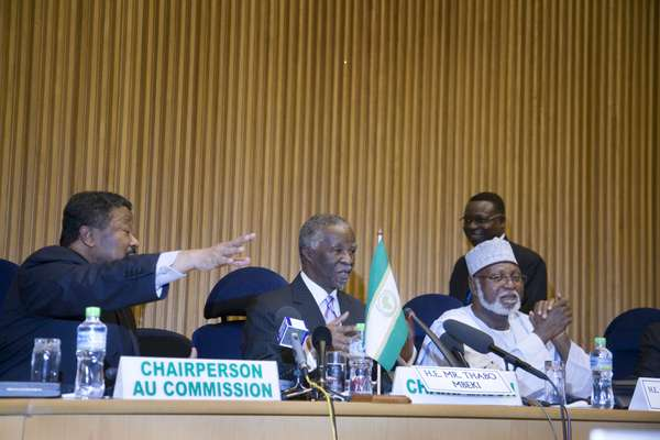 Chairperson of the AU Jean Ping (left) sits next to South Africa's Thabo Mbeki