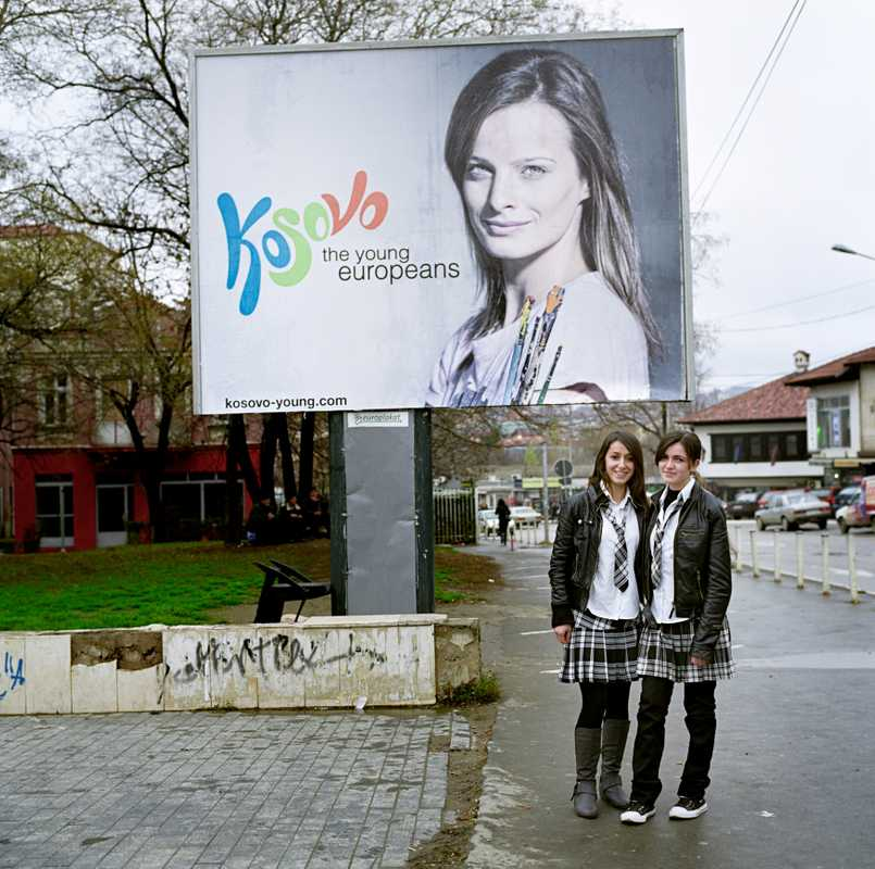 Teenagers in front of an ad, part of a state-funded campaign created by Saatchi & Saatchi