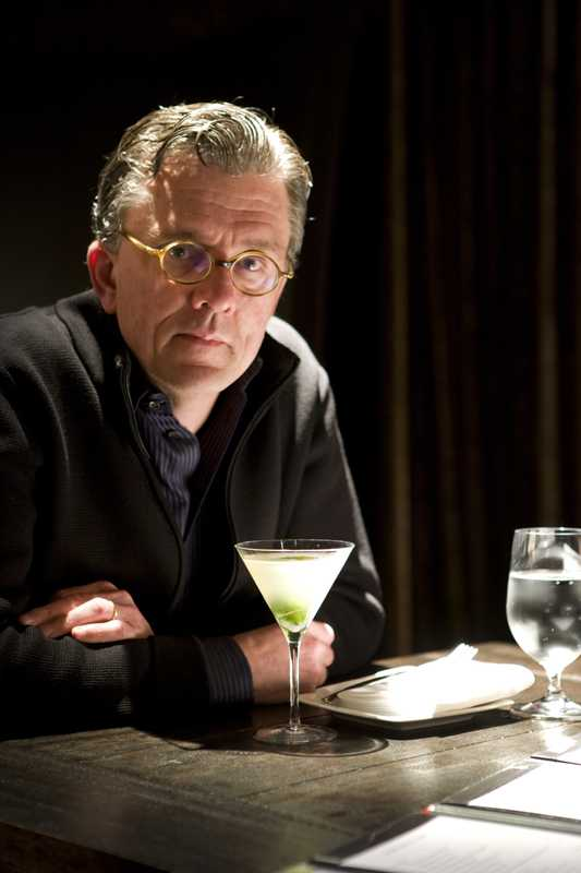 Andersen at his table with a gin gimlet