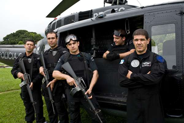 Police officers from the elite tactical unit, prepare to board the UH-1H helicopter