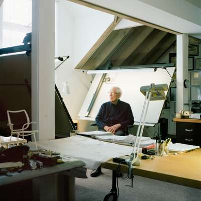 Niels Diffrient at the drawing board in his Connecticut studio