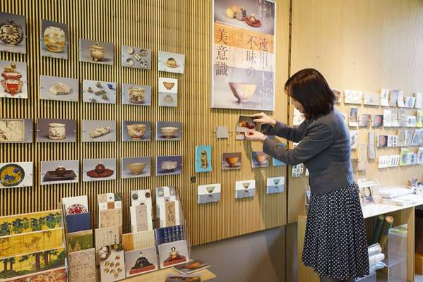 Mamiko Arakawa stocks postcards for a new exhibition at the Nezu Art Museum