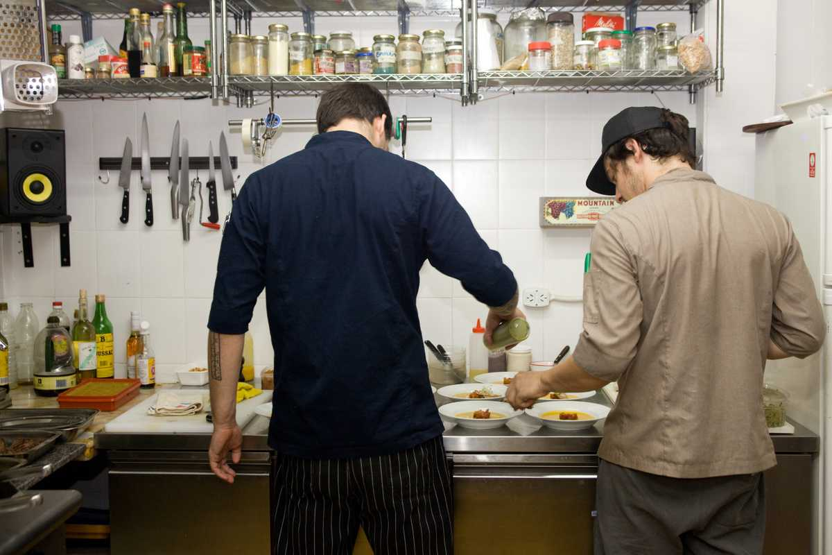 Chefs apply finishing touches in the kitchen