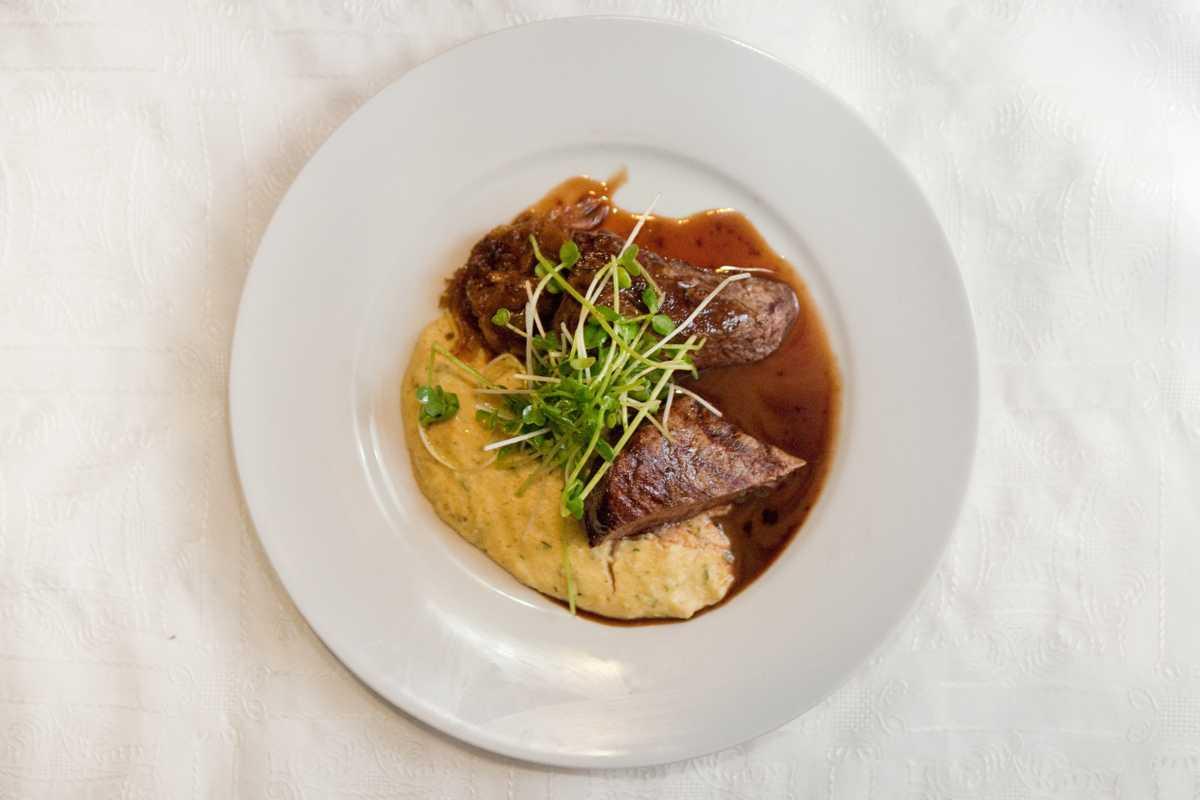 Steak with polenta and cognac sauce
