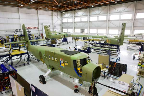 Three Twin Otters in various stages of assembly in the Calgary hangar