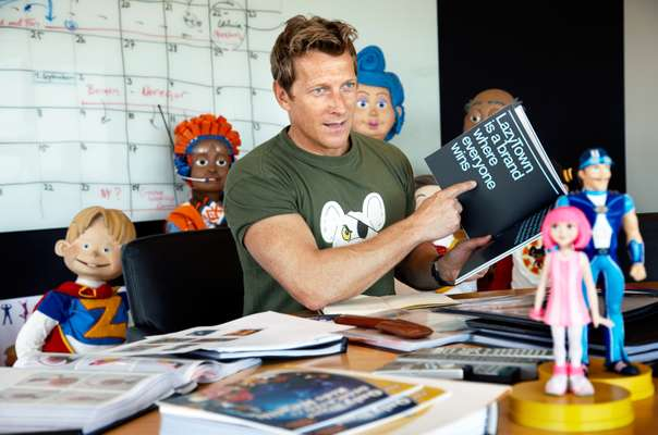 Magnus Scheving in LazyTown studios surrounded by his characters