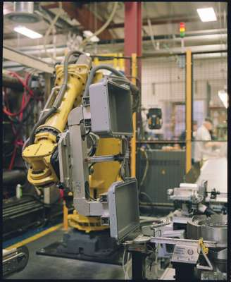A robot moves the case along the production line