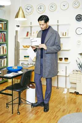 Coat by United Arrows, jacket and trousers by Prada,  jumper by Fedeli, shoes by JM Weston