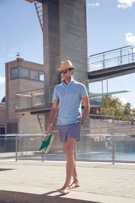 Hat by Bates, polo shirt by Zegna Sport, swim trunks by Canali, shoes by Rivieras, watch by Bell & Ross