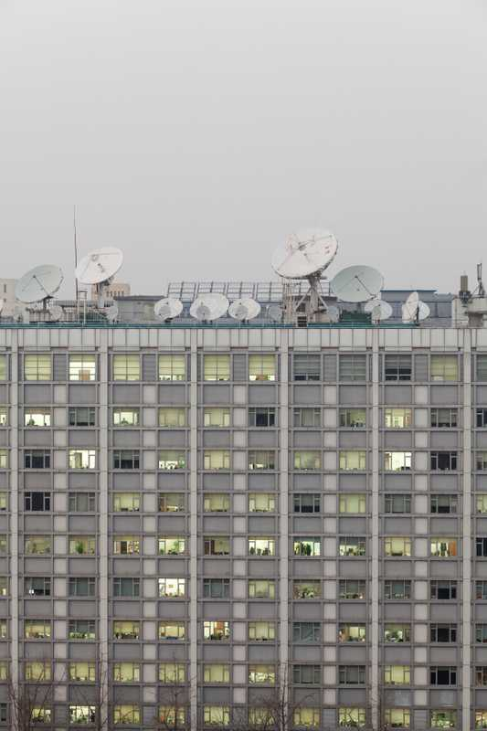 Satellite dishes on a Xinhua office building