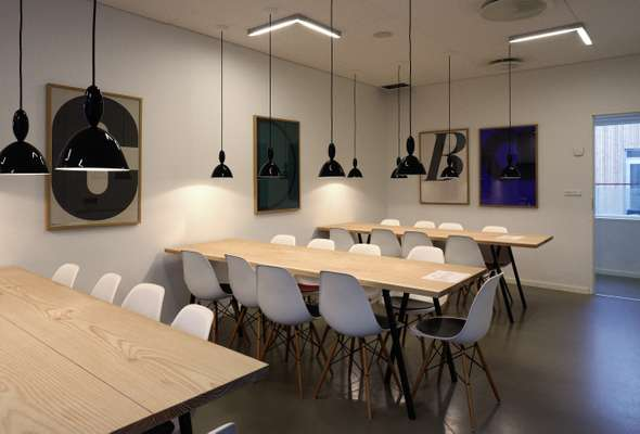 Canteen with lights by Muuto and Eames chairs