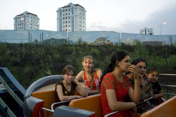 Russians and Turkmen on a ride at 'Disneyland'