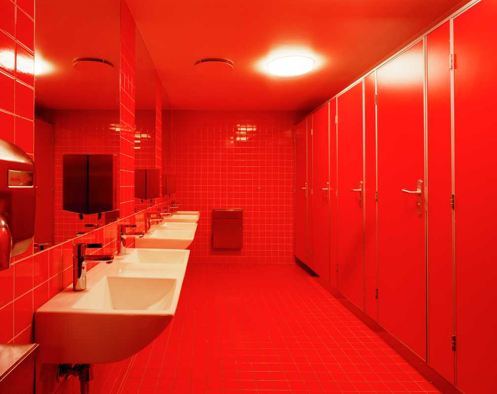 The girls' loos are decorated in floor-to-ceiling red