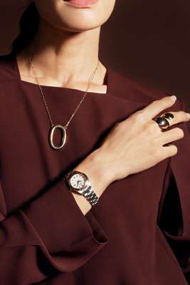 Pullover top by Cos, necklace by Laura Lombardi, ring by Charlotte Chesnais, watch by Grand Seiko