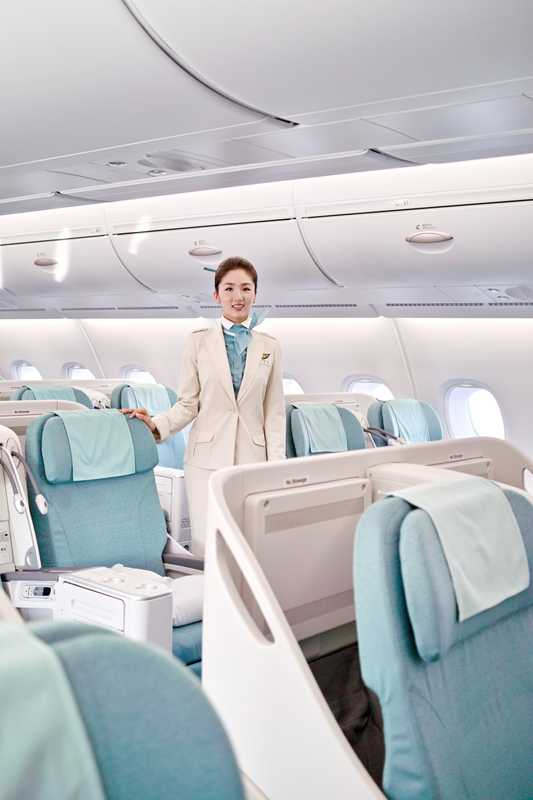 Flight attendant in business class