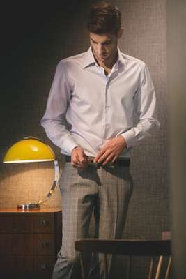 Shirt by Canali, T-Shirt by Gunze, Trousers by Gucci, Belt by Hackett.