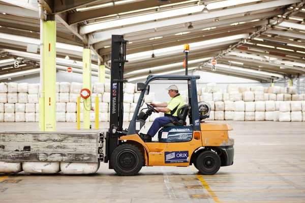 An AWH forklift operator picks up wool bales at Yennora Wool Selling Centre