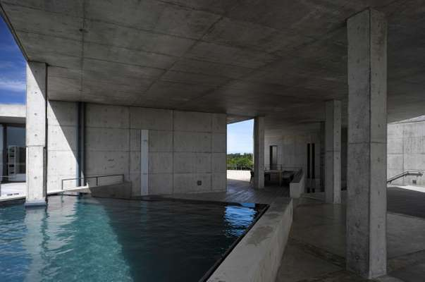 Swimming pool set at an angle to the surrounding walls
