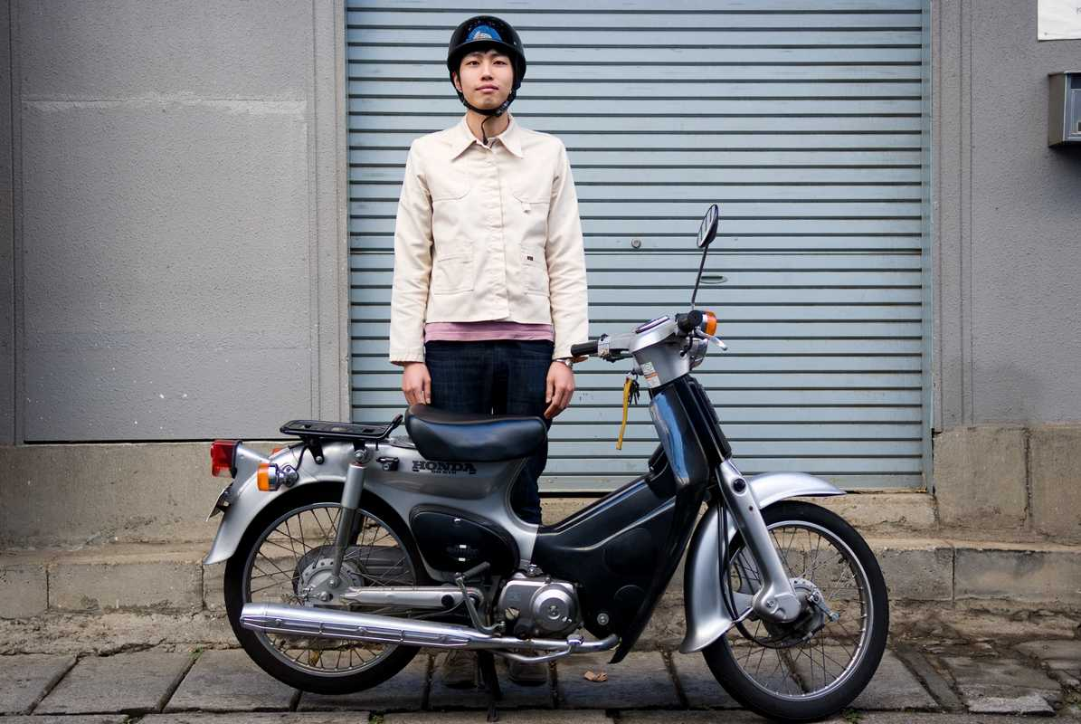 Hiroto Nishino, 24, works in a clothing shop and has been a scooter rider for three years, using it to get around town. He rides a Honda Super Cub