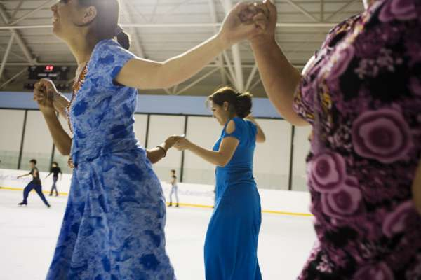 Skaters hold hands at Ashgabat's ice rink