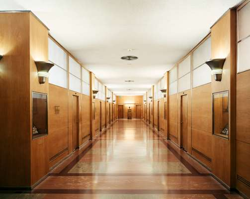 The eighth floor of Building 21 has been refurbished but retains original features such as linoleum flooring and wood-panelled walls